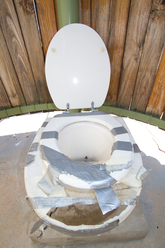 Nothing like duct tape to keep a long drop toilet from falling apart completely.