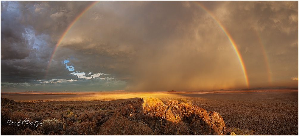 Flaming double rainbow while shooting with the sun into the rain during a thunderstorm in the Tankwa karoo