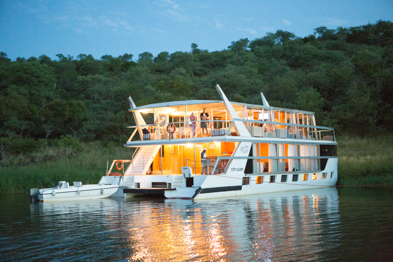 The houseboat docks at a different scenic spot along the dam's shoreline every evening.
