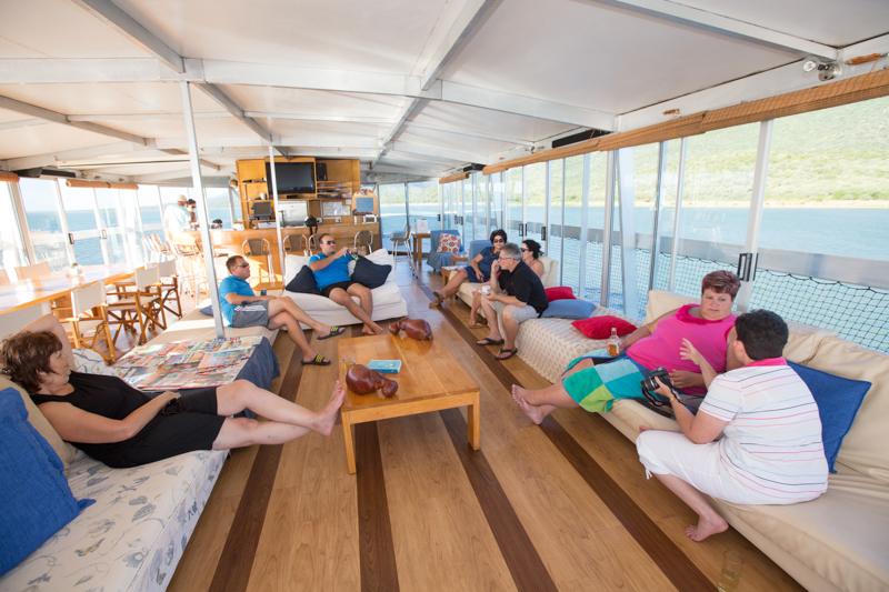 The Shayamanzi II Houseboat has many comfortable sofas and lots of space.